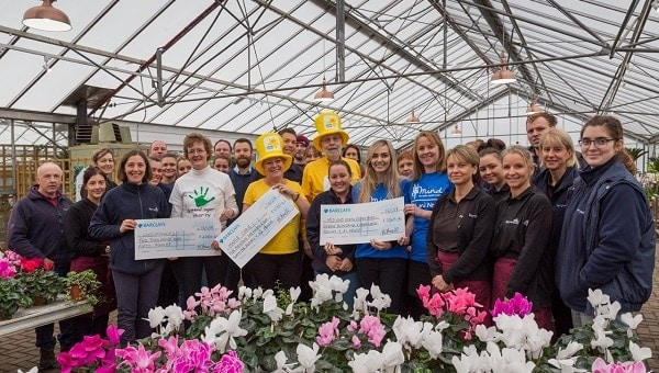 Perrywood hands over £14,000 worth of cheques to charities